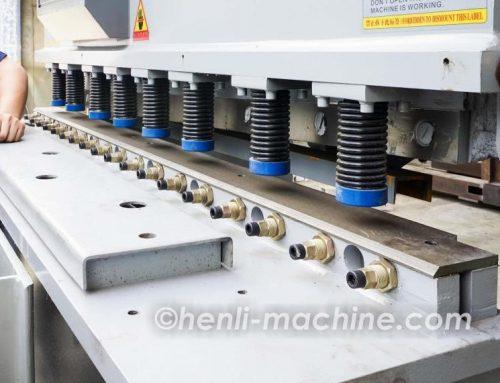 Guillotine type shearing machine